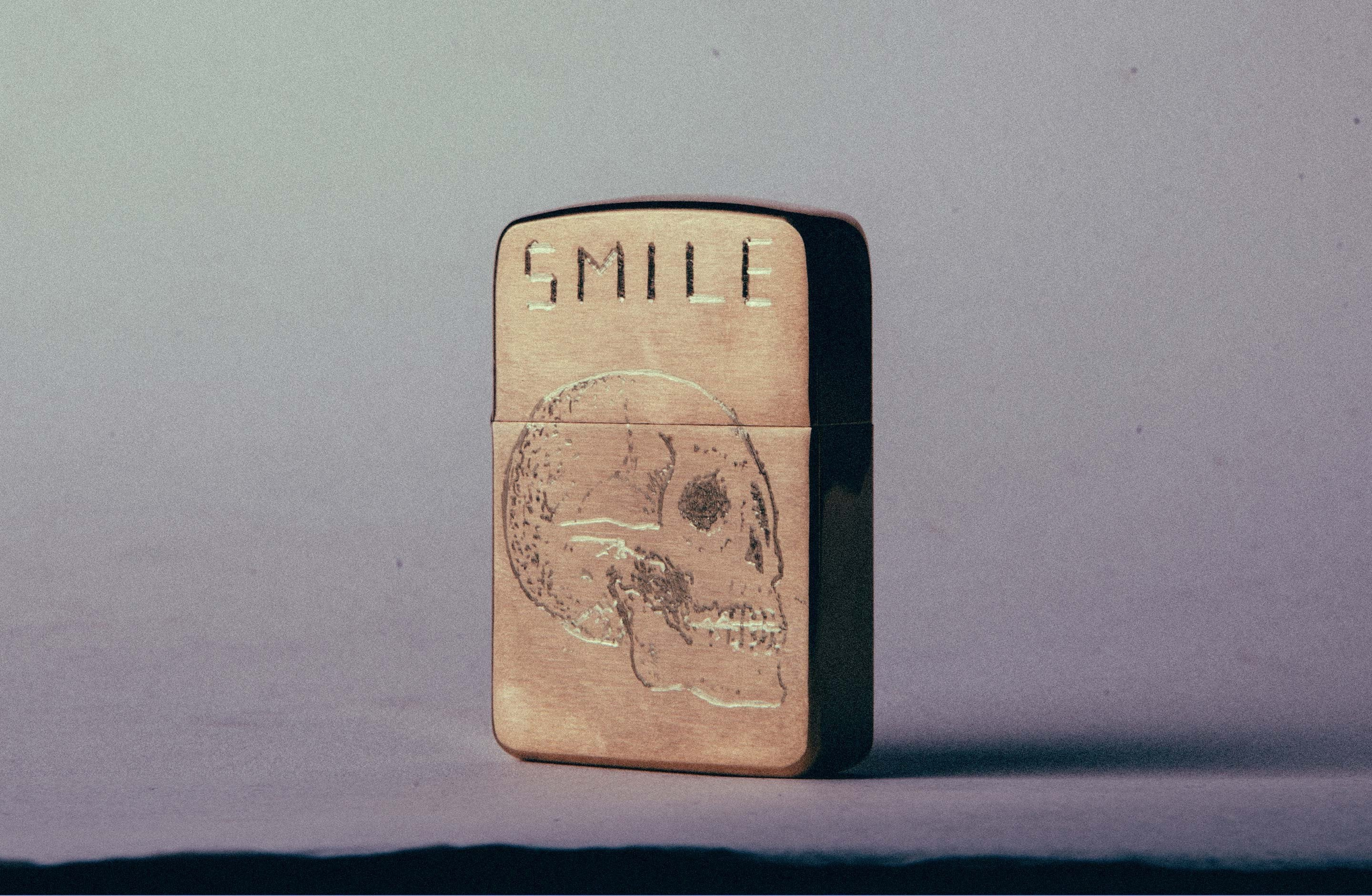 "imogene + willie - engraved ""death smile"" brass zippo"