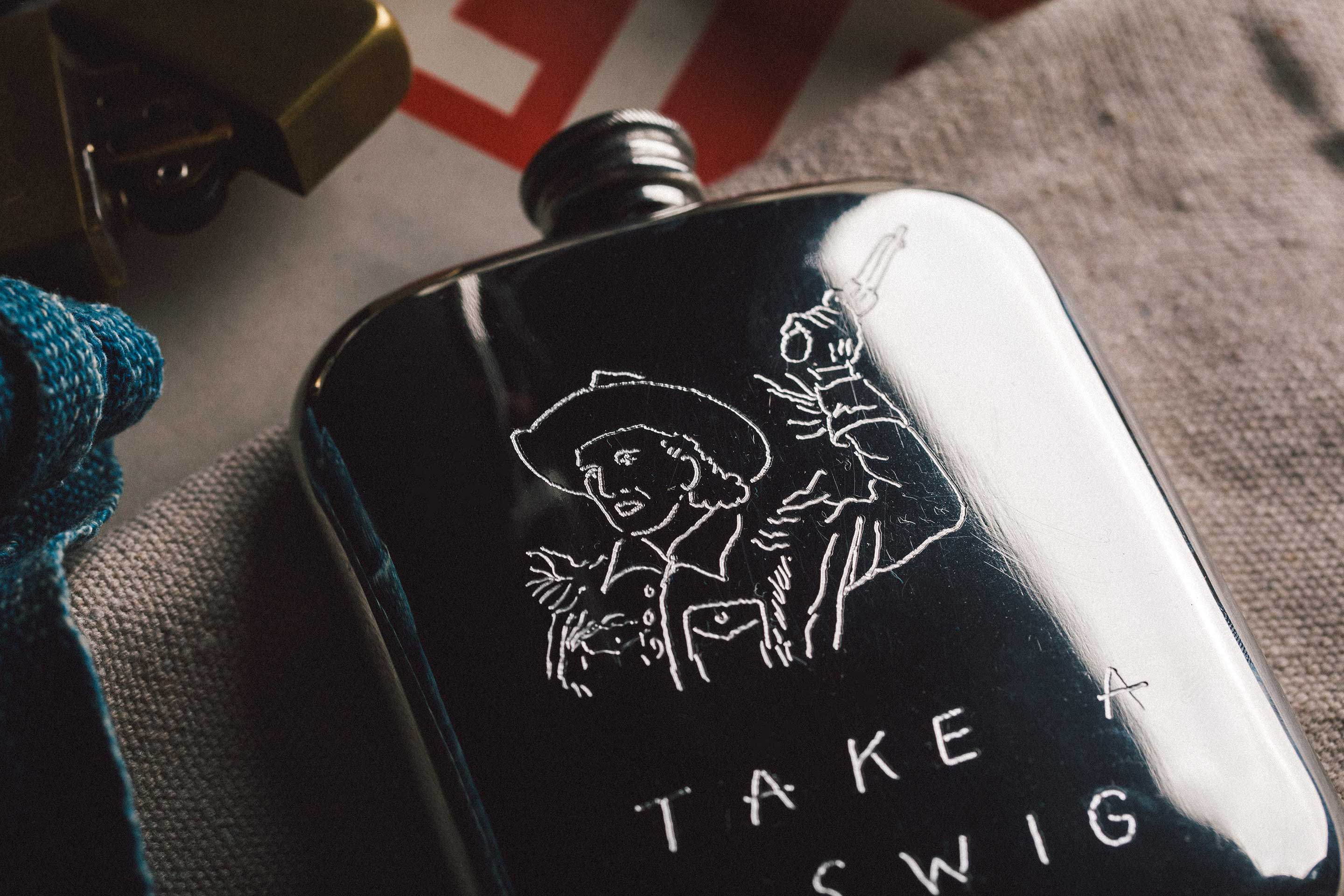 "imogene + willie - engraved ""take a swig"" flask"