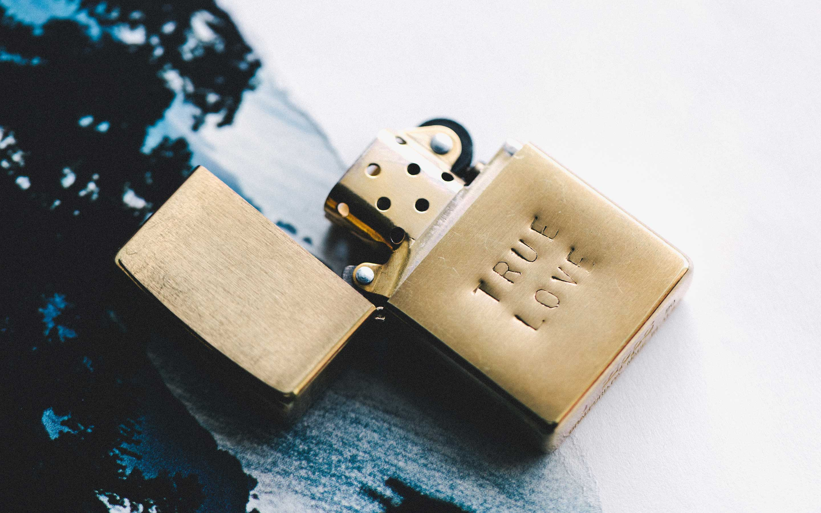 "imogene + willie - hand stamped ""true love"" zippo"