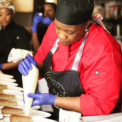 Chef Rozi plating up Liberian Ricebread at @JamesBeardFoundation