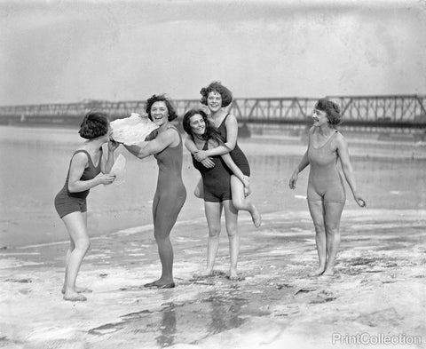 Five Women in Swimsuits on Icy Beach