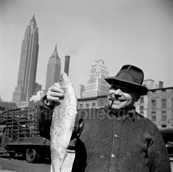 New York, New York. Stevedore Holding Fish