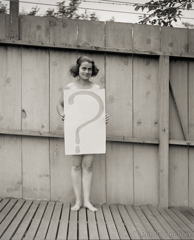 "Unclothed Woman Behind ""?"" Sign"