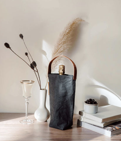 Wine in a black sustainable wine tote