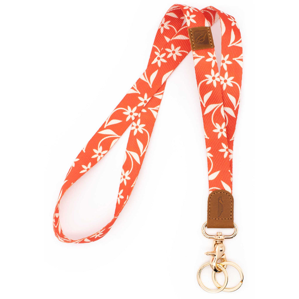 Orange white floral patterned neck lanyard brown leather hardware metal clasp with 2 key rings