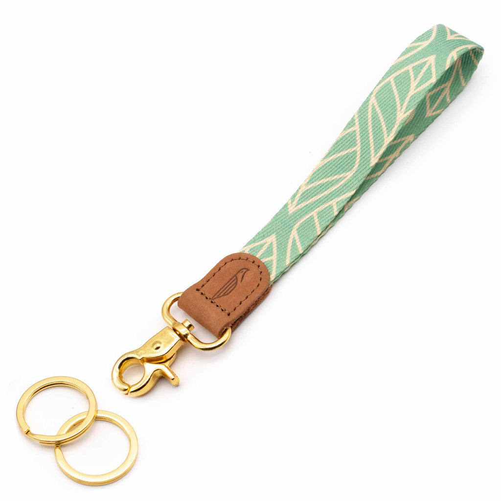 Hand wrist lanyard blue mint cream leaves patterned brown leather hardware gold metal clasp with 2 key rings