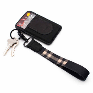 Black and cream color plaid hand wrist lanyard with keys and with black leather slim wallet