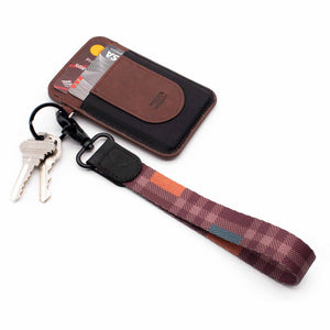 tartan plaid pattern plum color hand wrist lanyard with keys and burgundy slim wallet