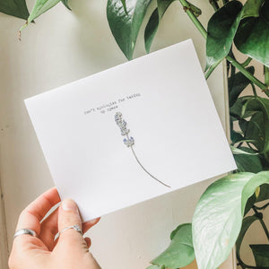 don't apologize for taking up space greeting card on white paper paired with a pressed flower