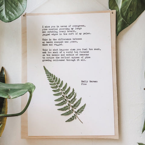 poem by emily harman, pine typed in typewriter font on white paper, mounted on birch wood and paired with a pressed flower. handmade décor by flora & phrase
