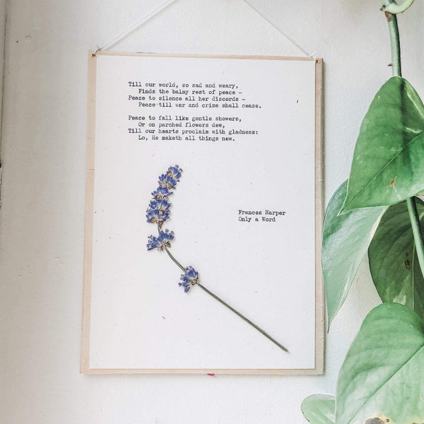 poem by frances harper, only a word typed in typewriter font on white paper, mounted on birch wood and paired with a pressed flower. handmade décor by flora & phrase