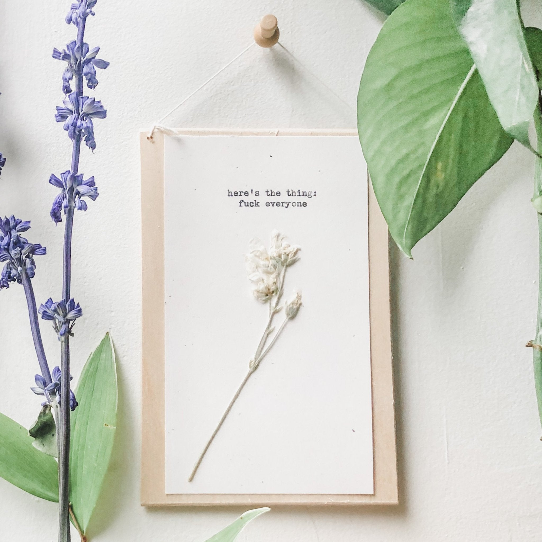 here's the thing: fuck everyone quote typed in typewriter font on white paper, mounted on birch wood and paired with a pressed flower. handmade décor by flora & phrase