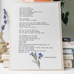 mushawn knowles, how are the children quote typed in typewriter font on white paper, mounted on birch wood and paired with a pressed flower. handmade décor by flora & phrase