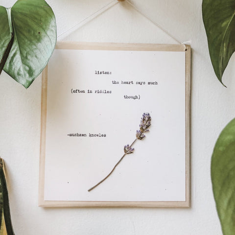 mushawn knowles, listen quote typed in typewriter font on white paper, mounted on birch wood and paired with a pressed flower. handmade décor by flora & phrase