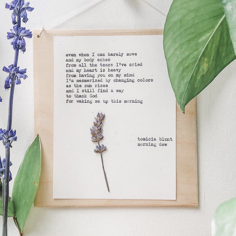 tomicia blunt, morning dew quote typed in typewriter font on white paper, mounted on birch wood and paired with a pressed flower. handmade décor by flora & phrase