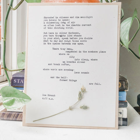 zoe branch, 4:33 a.m. quote typed in typewriter font on white paper, mounted on birch wood and paired with a pressed flower. handmade décor by flora & phrase