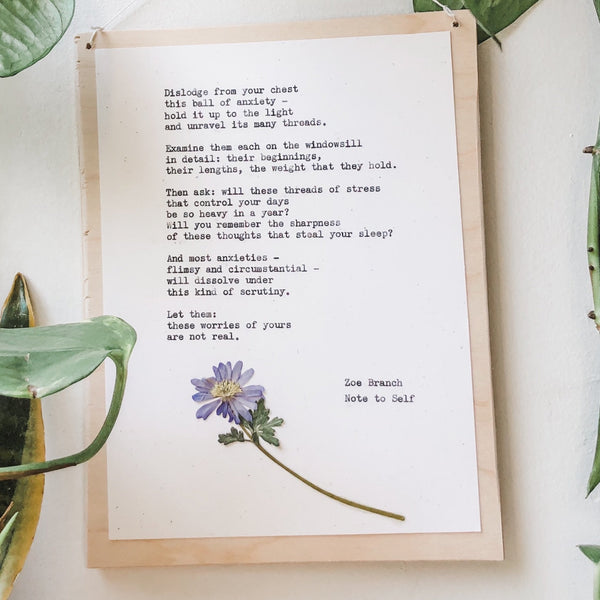 zoe branch, note to self poem typed in typewriter font on white paper, mounted on birch wood and paired with a pressed flower. handmade décor by flora & phrase