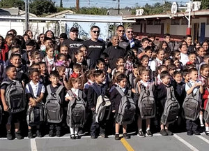 Purist Group Delivers 3000 Backpacks
