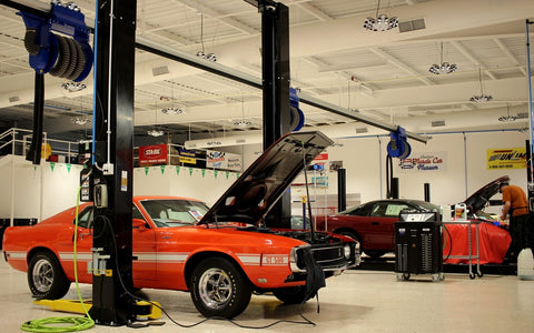 Maintenance shop using CTEK professional battery chargers at the American Muscle Car Museum.