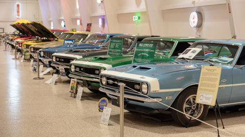 Row of classic cars on display at the American Muscle Car Museum.