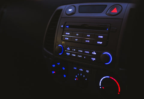 Black car radio with blue electronic buttons