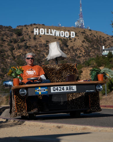 Edd China with the Casual Lofa motorized sofa near the Hollywood sign.