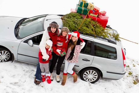 Christmas family around holiday car