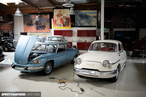 Blue and white car at Jay Leno's Garage attached to CTEK battery charger.