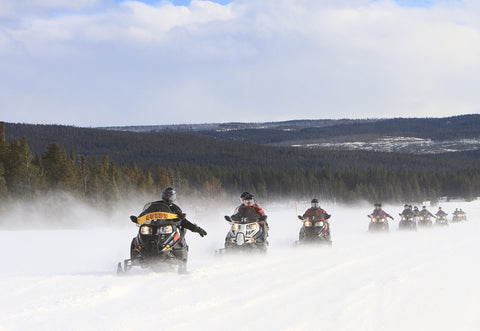 Line of snowmobile riders