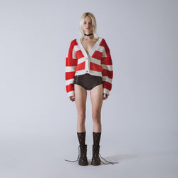 Short cardigan in knit with neogrunge stripes enhanced with jewel buttons.