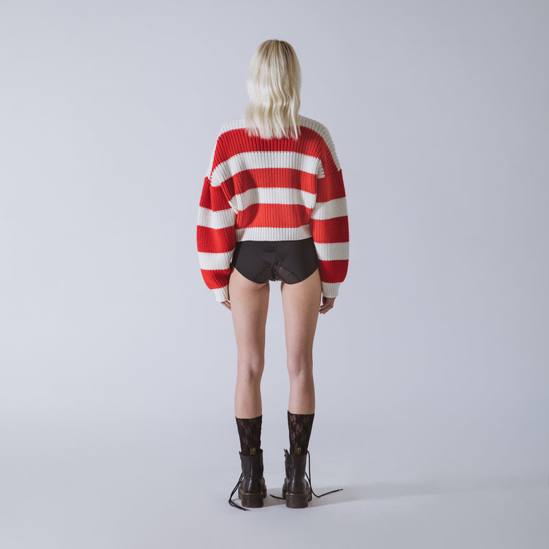Short cardigan in knit with neogrunge stripes enhanced with jewel buttons
