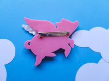 Flying pig laser cut acrylic brooch.