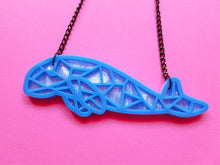 Dugong laser cut acrylic necklace.