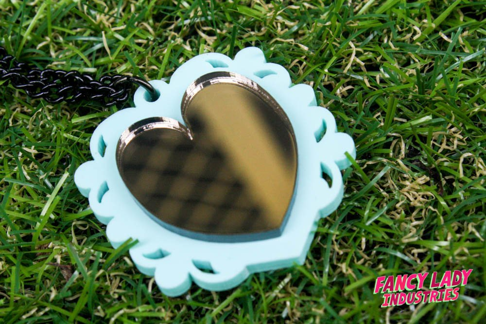 Bronze mirror on mint ornate frame acrylic necklace.