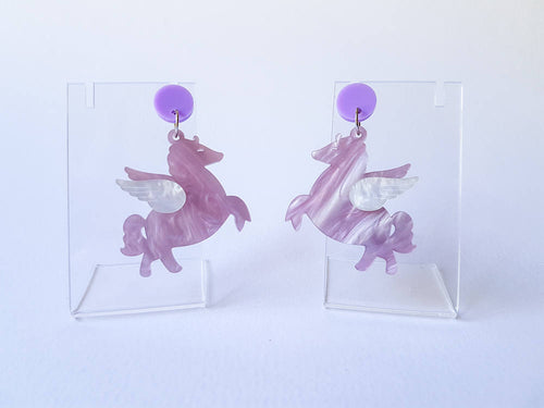 Lavender chubby pegasus acrylic earrings.
