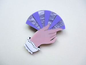 Fancy hand holding a fan acrylic brooch.