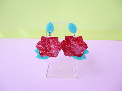 Red rose dangling acrylic earrings with small etched spider.