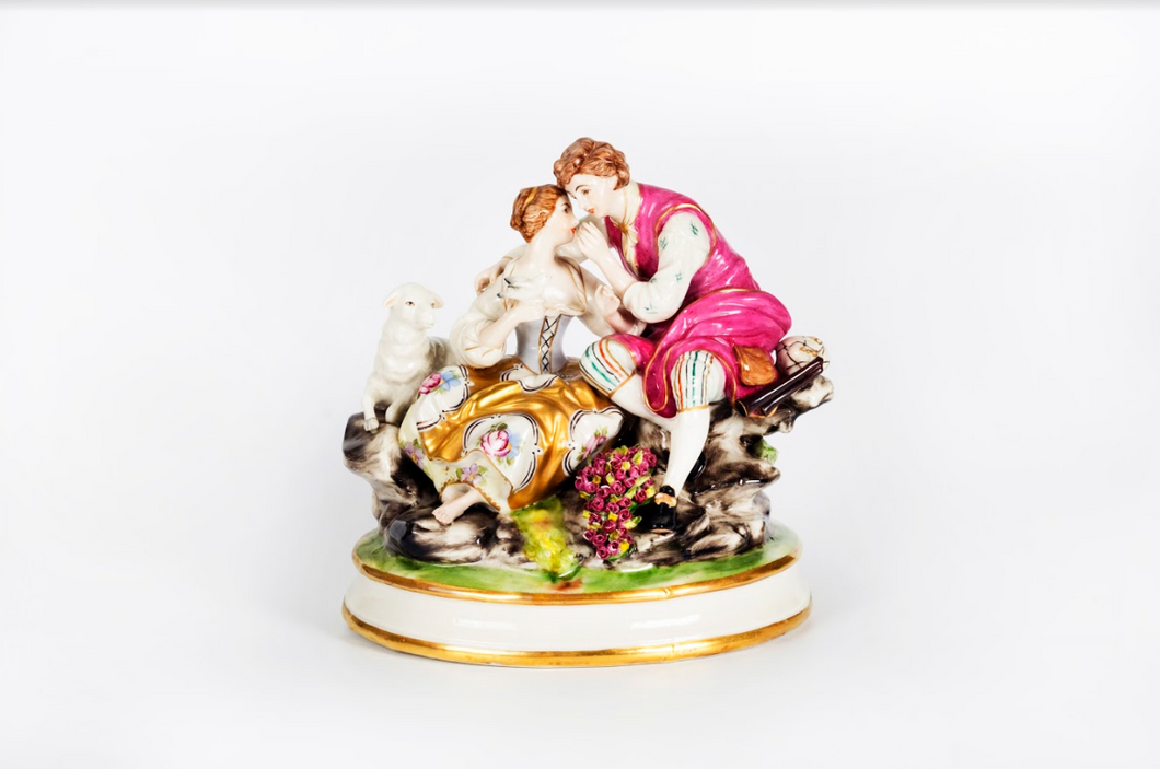 Porcelain Figurine of a Couple in Conversation Germany, Late 19th Century