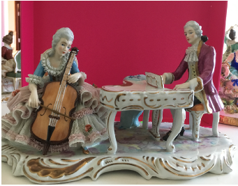 A Figurine of a Couple Playing The Piano And Cello Porcelain German, 19th Century
