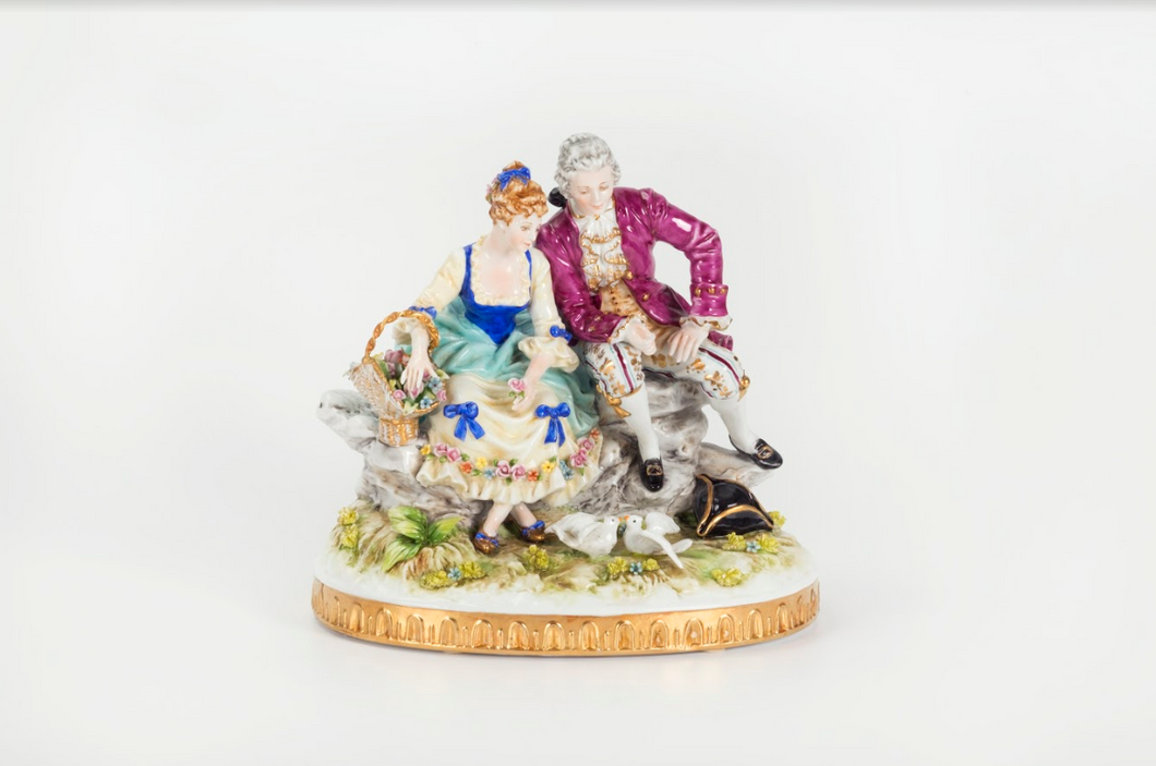 Porcelain Figurine of a Couple Seated with 2 Doves