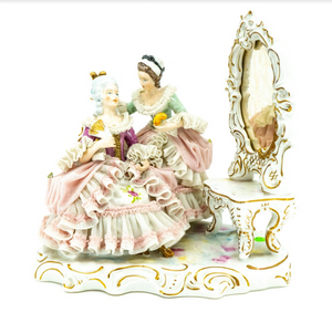 A figurine of a Woman at her Dressing Table, Hand-Painted Porcelain, German Late 19th Century