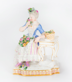 A  figurine of a seated woman with flowers