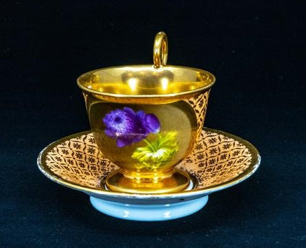An Empire Style Cup with Saucers, Gilded Porcelain, Paris, early 19th Century