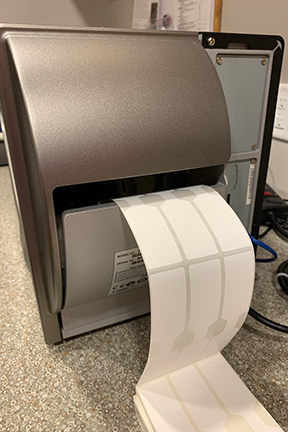Fanfold Labels Loaded Into A Thermal Printer Through The Rear Slot