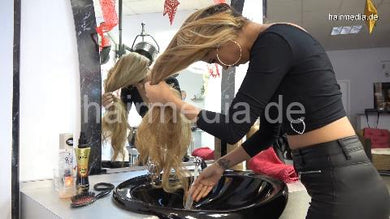 9092 Zoya 1 XXL hair self shampooing in leatherpants in salon