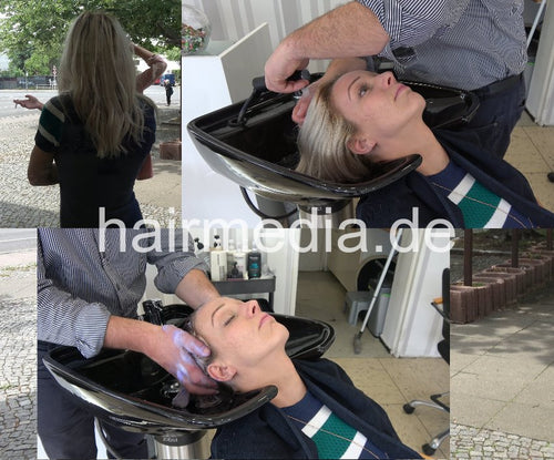 Salon owner shampooed backward by barber