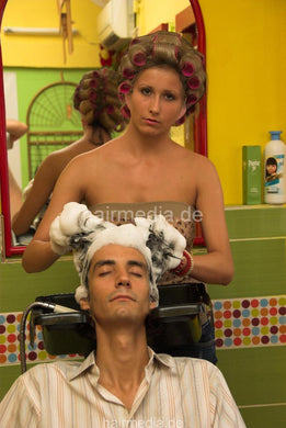 296 by Sanja 1 male client backward salon shampooing by barberette in rollers, hairnet, earprotectors