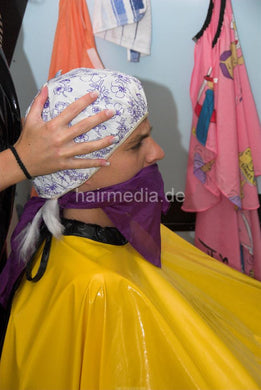 898 3 Sandra forced perm handcuffed in very heavy pvc cape