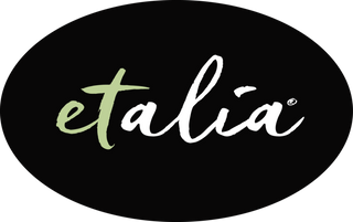 Etalia logo - green and white scripted lettering on a black oval background