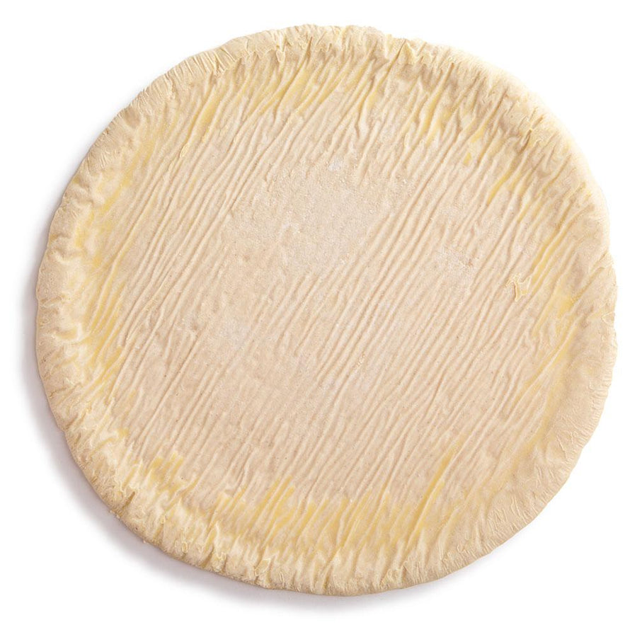 Unbaked Etalia Nudo pizza dough on white background from top down